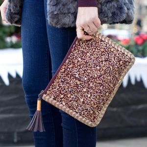 Target sequined clutch with tassel pull